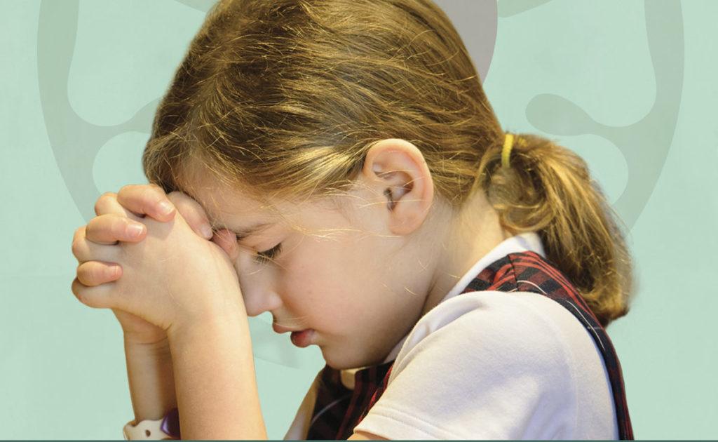 chapel service. girl praying.