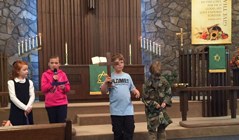 children leading chapel