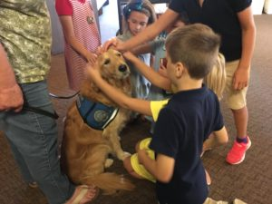 children petting comfort dog immanuel lutheran church joplin missouri