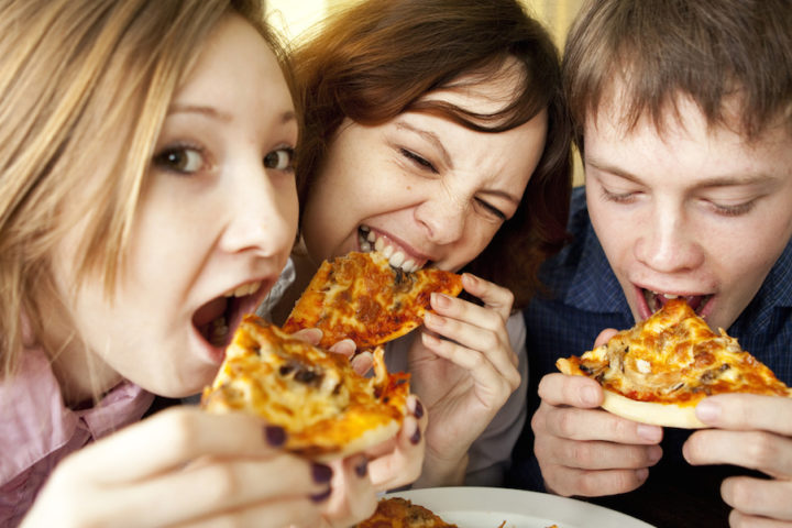 youth eating pizza