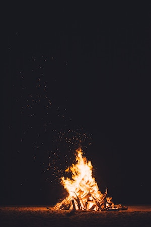 small fire with sparks swirling upward