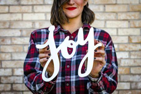 woman holding joy. A Time For Joy. Advent Devotion. Immanuel Lutheran Church. Joplin, Missouri. LCMS. Call His Name Jesus.