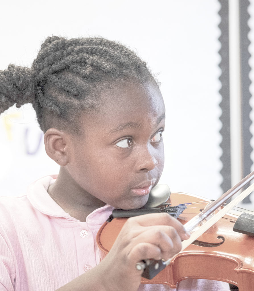 national lutheran schools week. girl playing violin. music class. 2020.