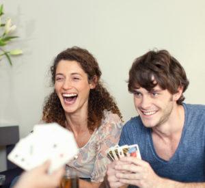 friends playing cards. adult fellowship game night. immanuel lutheran church lcms. joplin, missouri.