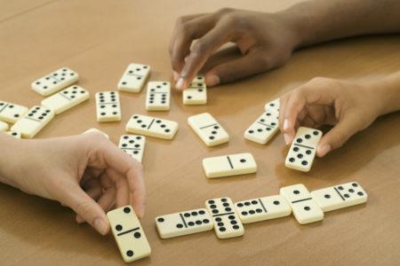 people playing dominoes. adult fellowship game night. immanuel lutheran church lcms. joplin, missouri.