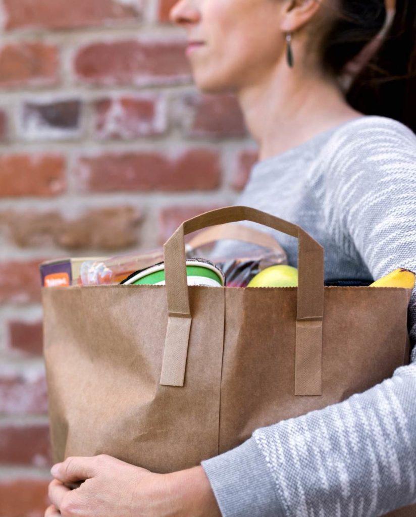 woman carrying groceries. coronavirus covid-19 help with shopping and errands. volunteer. Immanuel Lutheran Church LCMS. Joplin, Missouri.