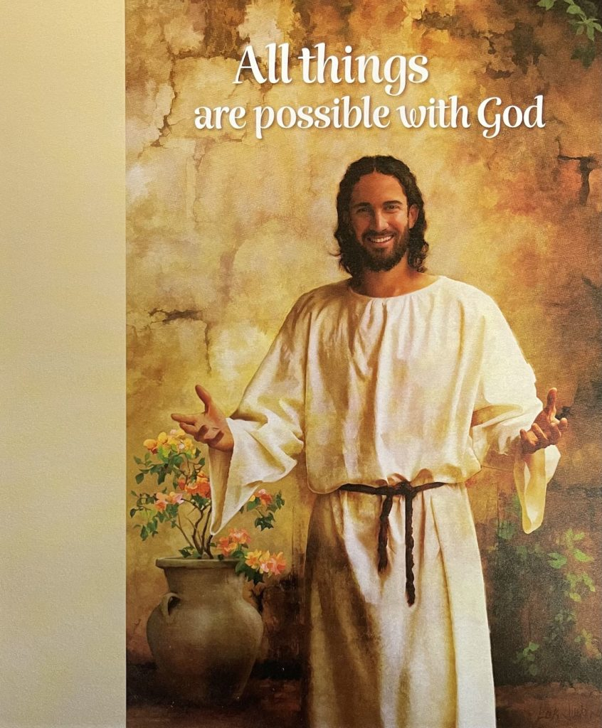 All things are possible with God. Jesus standing, smiling with hands reaching out.